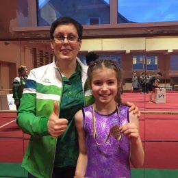 Trenerė N. Šigajeva su gimnaste